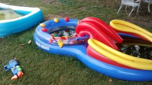 Neglected and dirty kids swimming pool in yard